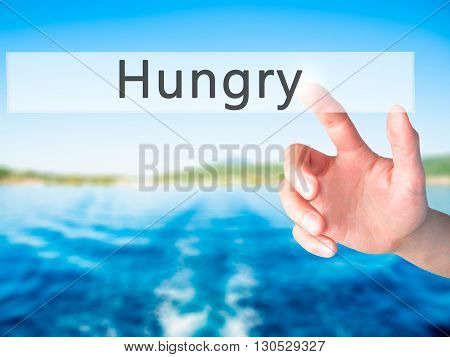 Hungry  - Hand Pressing A Button On Blurred Background Concept On Visual Screen.