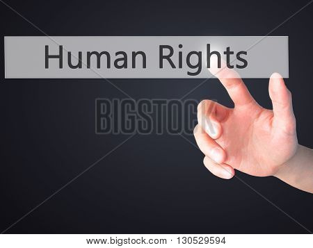 Human Rights - Hand Pressing A Button On Blurred Background Concept On Visual Screen.