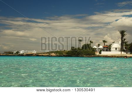 landscape from the sea with church to the shore background