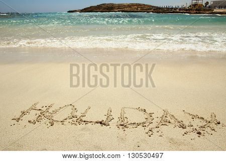 a holiday inscription on the beach summer