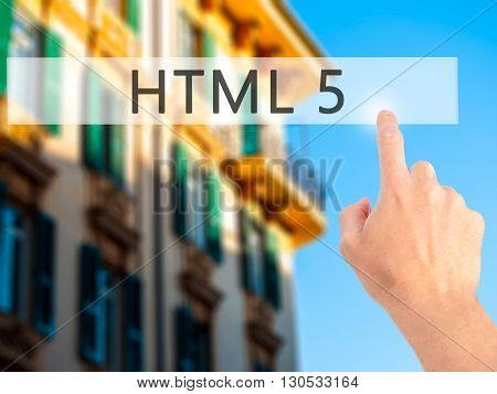 Html 5 - Hand Pressing A Button On Blurred Background Concept On Visual Screen.