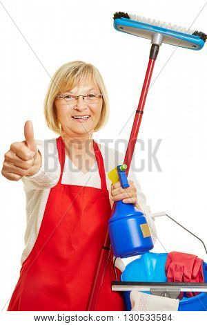 Happy cleaning lady holding thumbs up with many cleaning supplies in her hand
