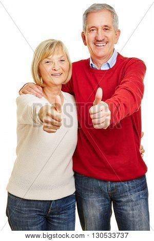 Happy senior couple holding thumbs up together