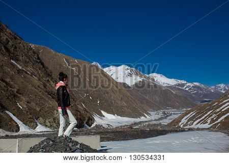 Young Sexy Woman Climbing Into The Mountains. Cute Fashion Girl Enjoying Stunning Views Of The Slope