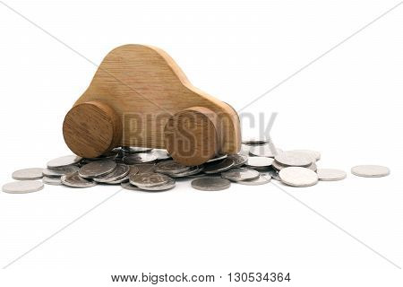 Wood car on a pile of coins on white background