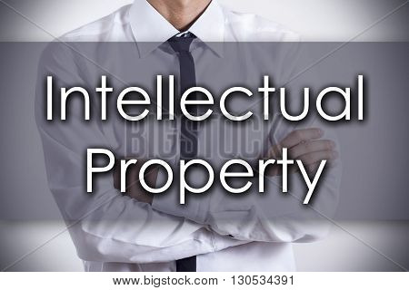 Intellectual Property - Young Businessman With Text - Business Concept