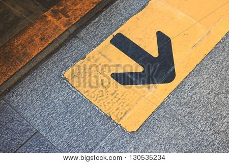 yellow arrow direction sign on asphalt opportunity choice for turn back