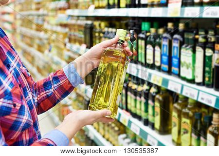 Buyer With Sunflower Oil In Store