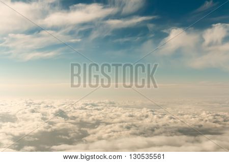 Sky scenery with different types of clouds, vintage effect, view from above