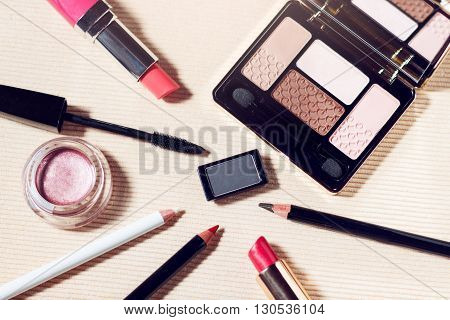 Makeup set of beige, brown, pink eyeshadows, eye pencil, lip pencil, lipstick and mascara