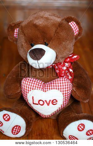 Fluffy cute soft toy teddy bear with heart love closeup