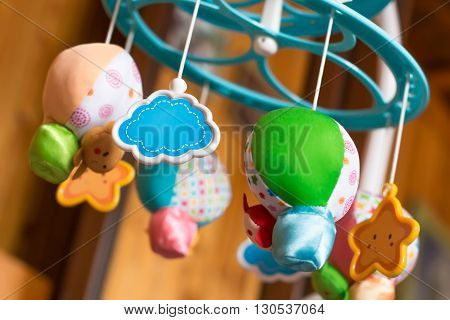 Child toy musical mobile air balloons with animals peeking out hanging on baby crib