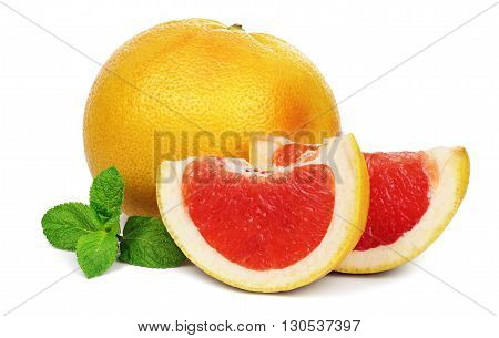 Ripe grapefruit and two slices with a twig of mint isolated on white background.