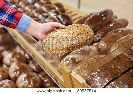 Buyer With Bread In Shop