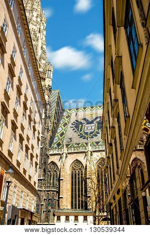 Fragment of Saint Stephen's cathedral with national emblem on the roof in the center of Vienna in Austria