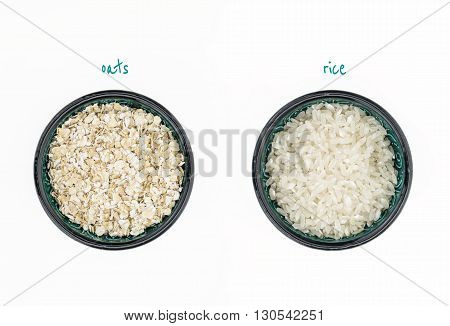 White Rice And Oatmeal In Bowls, On White Background