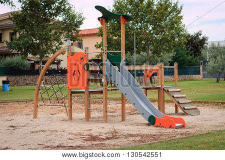 Сhildren's playground Multi - Unit with swings, see saw, springers, agility equipment, slide and sand pit