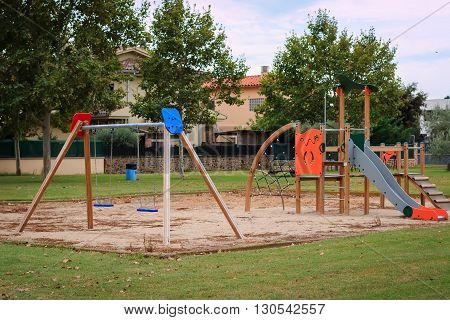 Сhildren playground Multi  Unit with swings, see saw, springers, agility equipment, slide and sand pit