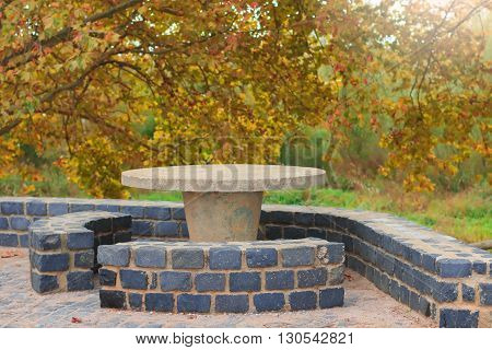 Picnic stone table in a secluded area for rest and relaxation