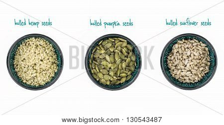 Hulled Hemp, Pumpkin And Sunflower Seeds In Bowls, On White Background