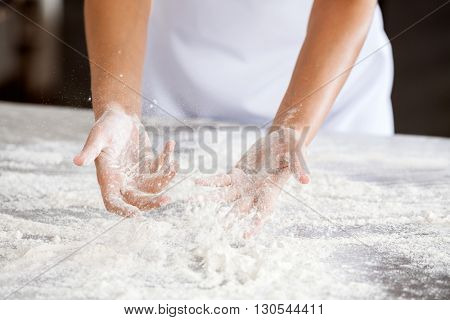 Midsection Of Baker Making Dough