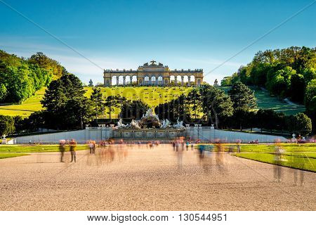 VIENNA, AUSTRIA - CIRCA APRIL 2016: Gloriette building in Schonbrunn gardens. This Palace is one of the most important historical monuments in Austria. Long exposure technic with blurred people