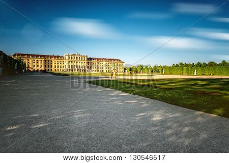 VIENNA, AUSTRIA - CIRCA APRIL 2016: Schonbrunn palace with alley in Vienna. This Palace is one of the most important historical monuments in Austria. Long exposure image technic with blurred clouds