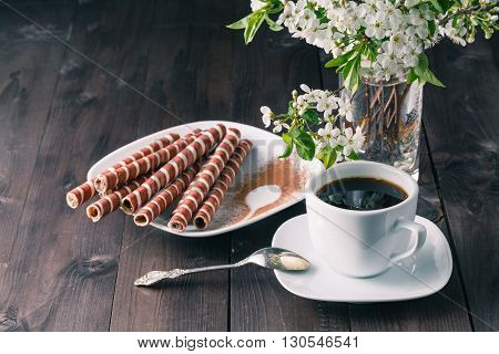 Coffee And Wafer Rolls On A Black Background