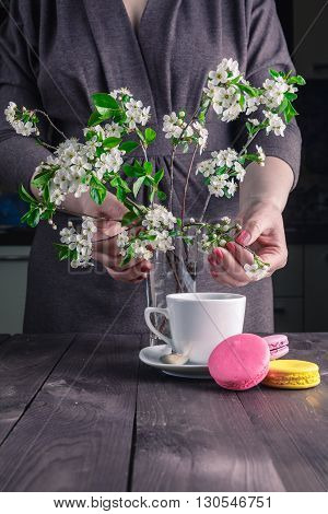 Cup Of Coffee And Cherry Blossom Branch On A Dark Background