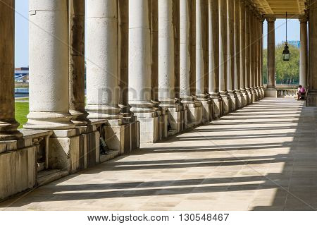 London, UK - May 9, 2016 - Colonnade and shadow in Old Royal Naval College University of Greenwich London.