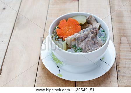 winter melon soup with pork spare rib on wood background
