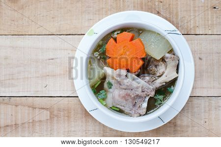 winter melon soup with pork spare rib on wood background,Top view