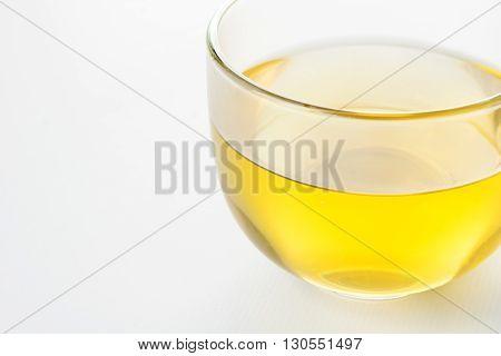 glass of green tea closeup on white