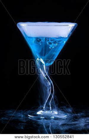 blue cocktail  and dry ice vapor