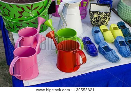 Watering cans on sale along with other gardening products.