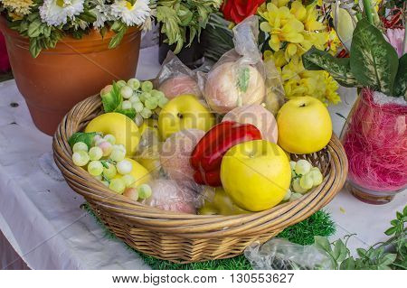 Fake fruits in basket on sale and display.