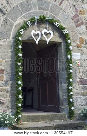 Door church and flowers at the end of wedding