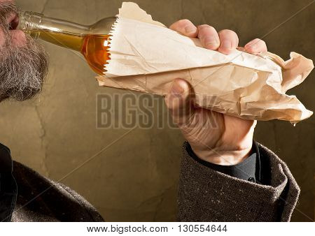 hard drinker with a bottle in the paper bag