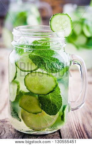 Detox water with cucumber lime and mint in mason jar