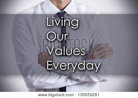 Living Our Values Everyday Love - Young Businessman With Text - Business Concept