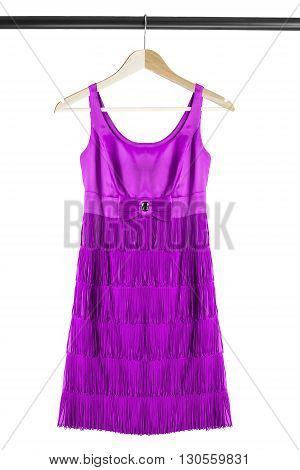 Purple cocktail dress on clothes rack isolated over white