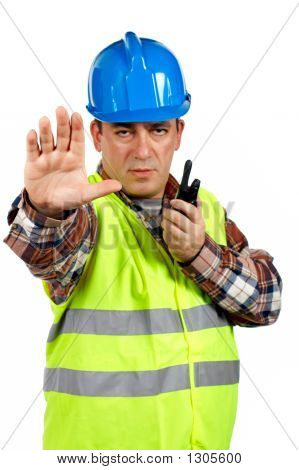 Construction Worker Talking With A Walkie Talkie And Orders To S