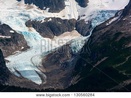 As the glacier flows down the mountain it takes a sweeping turn in a valley.