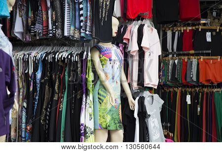 Hanoi, Vietnam - May 14, 2016: Front view of a fashion shop at Hang Dao old quarter street with dummy, mannequin wearing Chinese style dress and many kind of clothes behind in Hanoi capital.