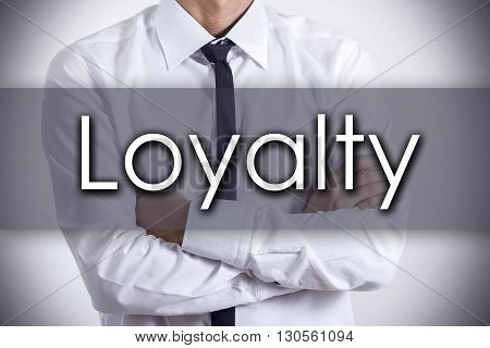 Loyalty - Young Businessman With Text - Business Concept