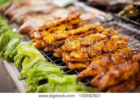 Fresh made chicken satay skewer. Traditional thai cuisine on market.