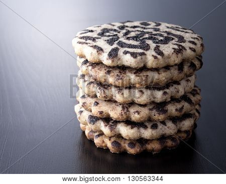 Taste chocolate biscuits tower on wooden background