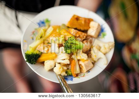 Fresh fried tofu with pumpkin brocolli and cauliflower. Traditional thai vegetarian cuisine.