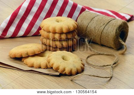 rustic holidays. Preparing for Christmas. Packing for gifts of homemade cookies. Home comfort Baking with cinnamon vanilla peanuts. Children will pack gifts for friends.