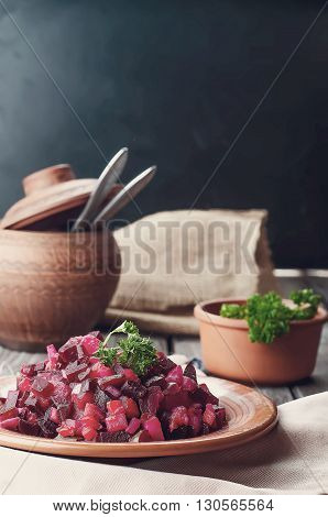 Traditional Ukrainian beetroot salad Vinegret, vegetable salad .Toned photo